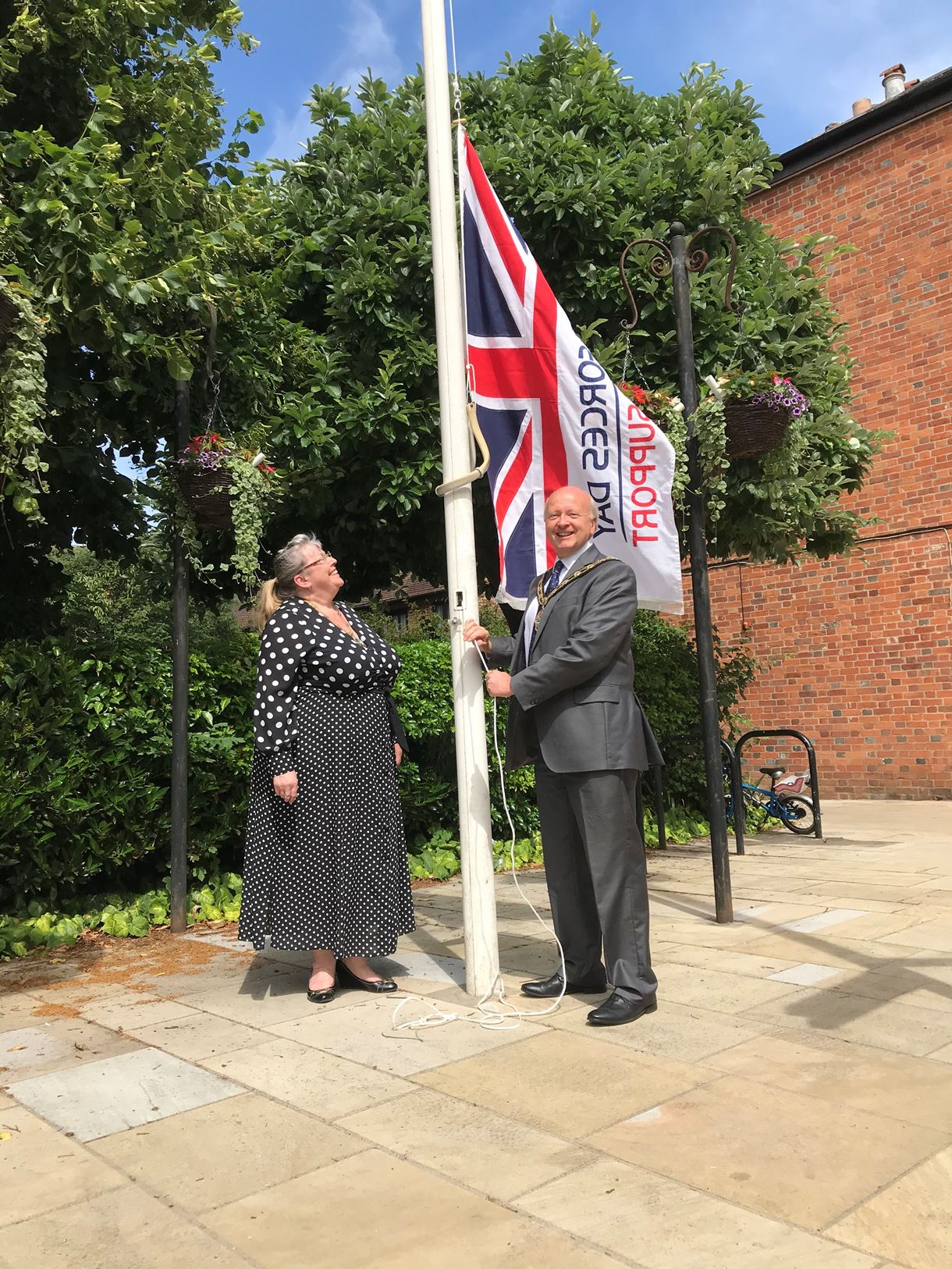 Mayor councillor Hatley raises the flag in Romsey