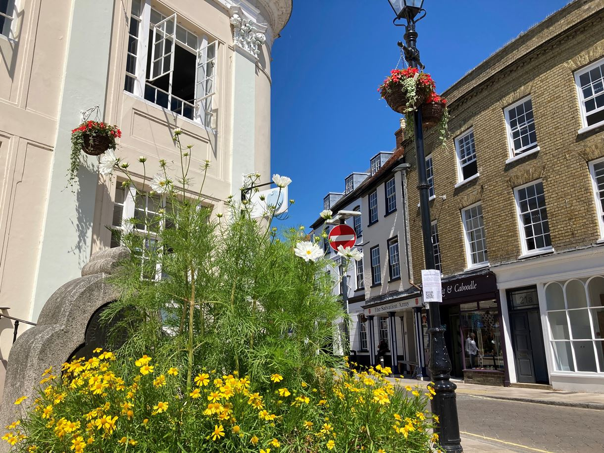 Hanging baskets in The Cornmarket, Romsey