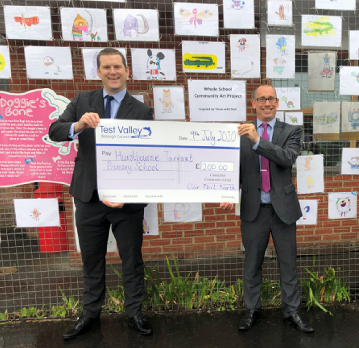 Cllr Phil North presenting the cheque
