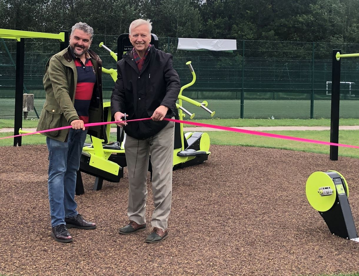 Councillors Thom and Dowden cut the ribbon for some of the new equipment at Knightwood Leisure Centre.
