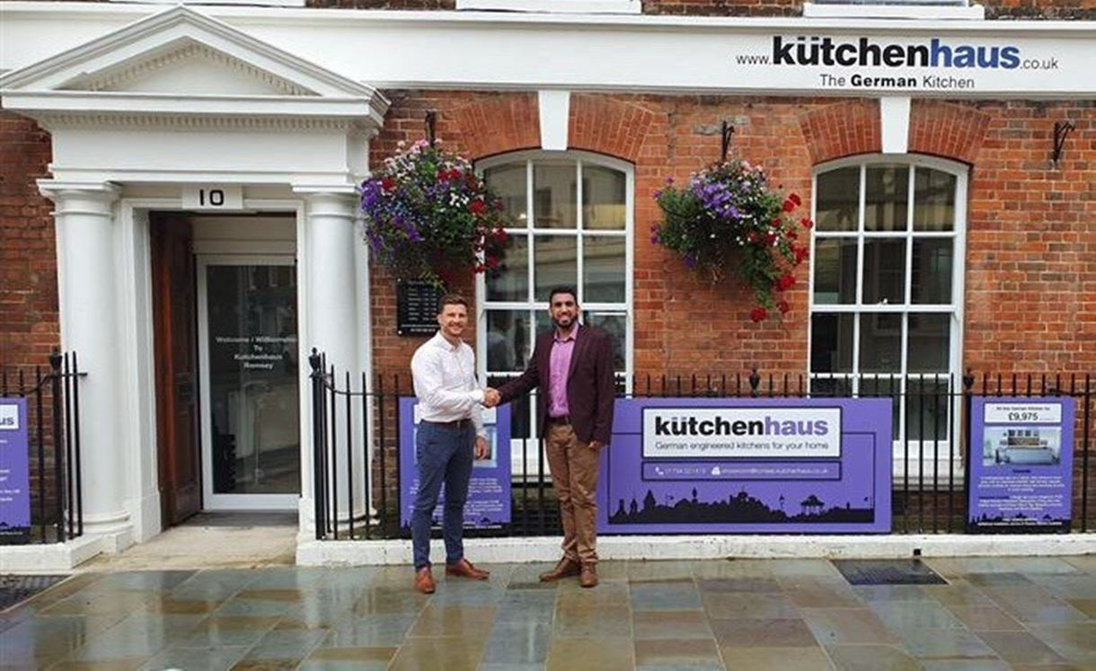 Councillor Daas awards the cheque to Paul Turner of Kutchenhaus in the Market Place