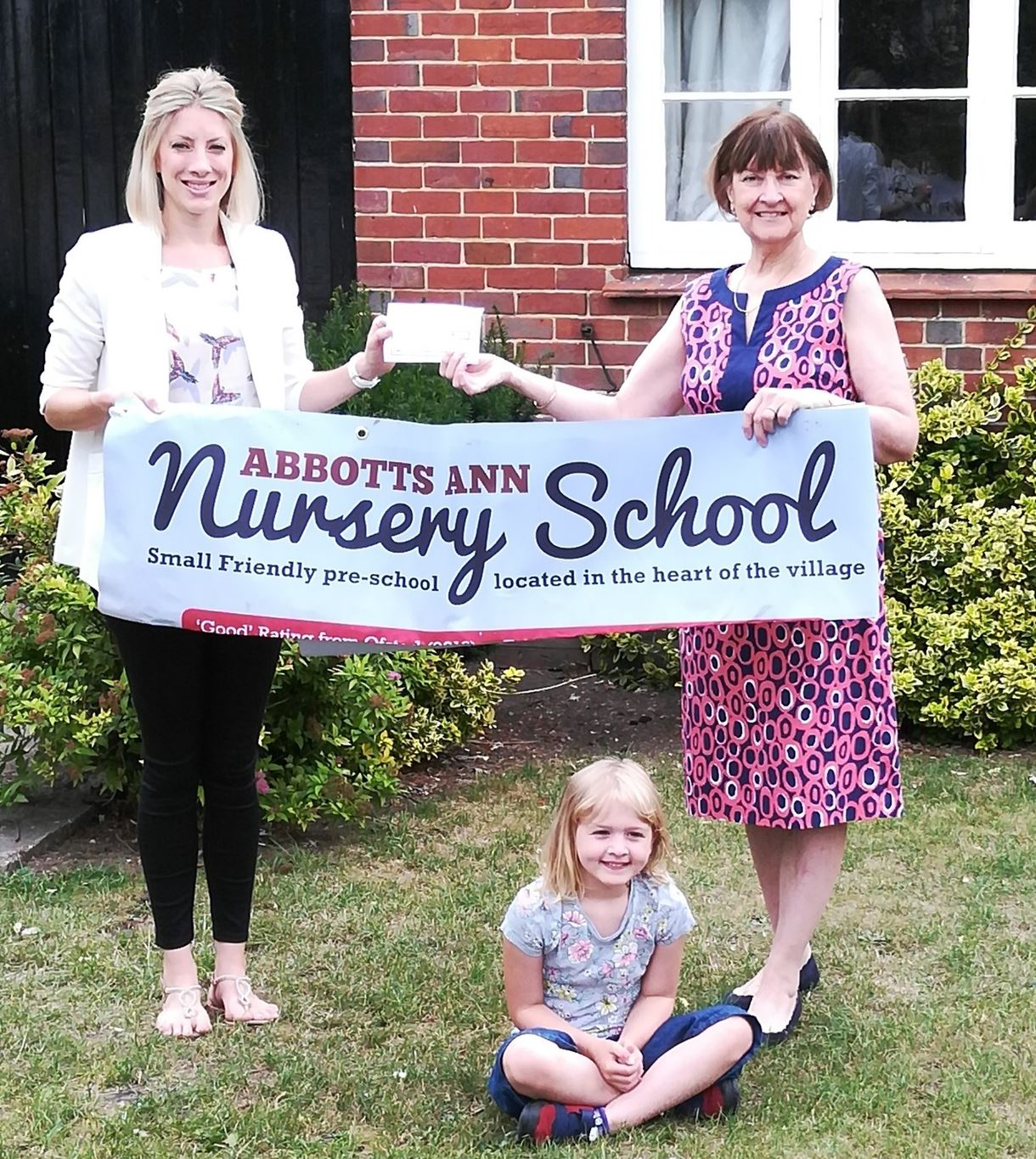 Nursery treasurer Anna Cooper with councillor Maureen Flood presenting the cheque.
