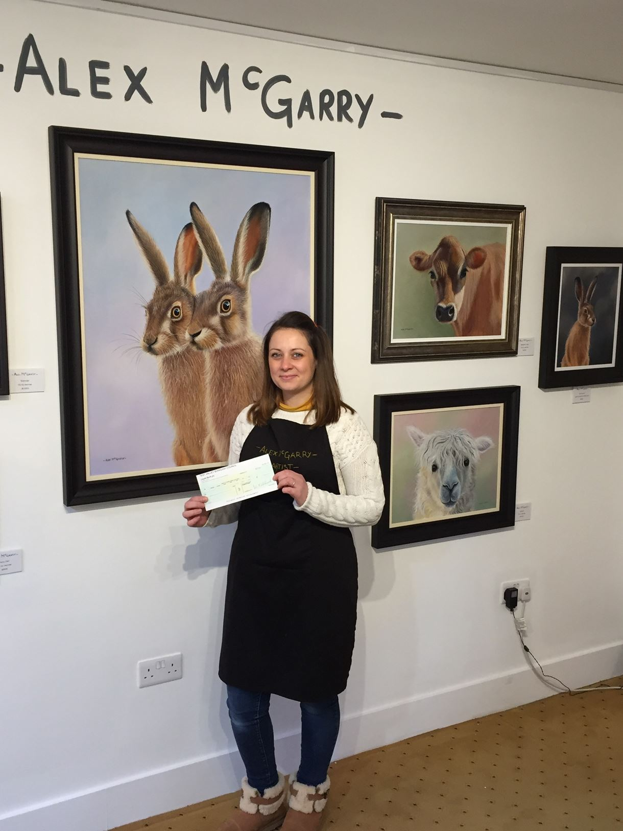 Alex McGarry in her studio in Waterloo Court, Andover, with the grant awarded by the council.